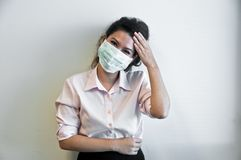 Business woman wear hygiene mask and sick. Business woman wears a green face hygiene mask and feels sick Stock Photo
