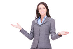 Business woman welcoming. Young business woman smiling with her arms open on white background Royalty Free Stock Photo