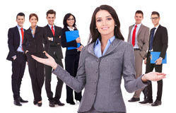 Business woman welcoming to her team. Business women leader welcoming to her successful team Stock Photos
