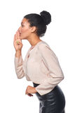 Business woman whispering gossip. Side view portrait of a mixed race caucasian - african american business woman whispering gossip, over white background stock photos