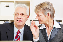 Business woman whispering secret Royalty Free Stock Photos