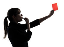 Business woman whistling showing red card silhouette. One business woman showing red card  silhouette studio isolated on white background Stock Image