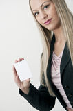 Business woman with white blank sign royalty free stock photography