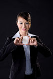 Business woman with white card. Asian business woman with white card on black background Stock Photography