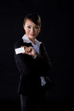Business woman with white card. Asian business woman with white card on black background Stock Photo