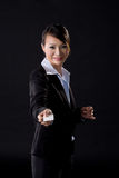 Business woman with white card. Asian business woman with white card on black background Stock Image