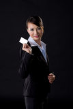 Business woman with white card. Asian business woman with white card on black background Stock Photos