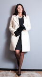 Business woman in a white coat Royalty Free Stock Photography