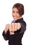 Business woman on white getting into a fight Stock Photo