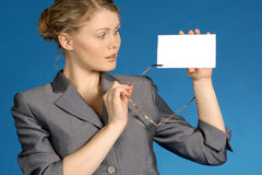 Business woman with white leaf. Woman with white leaf for text on a dark blue background Royalty Free Stock Image