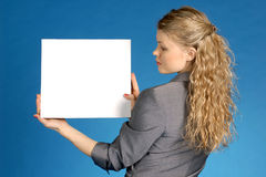 Business woman with white leaf. Woman with white leaf for text on a dark blue background Royalty Free Stock Photos