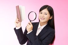 Woman with a magnifying glass. Business woman who checks the schedule Stock Images