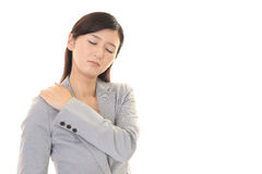 Business woman who has a shoulder pain. Stock Images