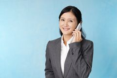 Business woman with a smart phone. Business woman who is talking on a smart phone royalty free stock photography