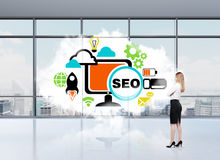 Business woman who thinks about SEO Royalty Free Stock Photo
