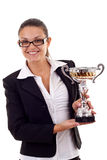 Business woman winning a trophy. Portrait of an attractive young business woman winning a trophy against white background Stock Photography