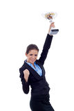 Business woman winning a trophy. Portrait of an excited young business woman winning a trophy against white background Stock Images