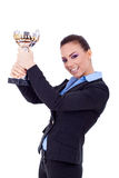 Business woman winning a trophy. Portrait of an excited young business woman winning a trophy against white background Royalty Free Stock Image