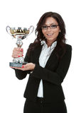 Business woman winning a trophy. Portrait of an attractive young business woman winning a trophy against white background Royalty Free Stock Image