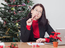 Business woman while winter holidays. Business woman making a christmas present wish list Stock Photo