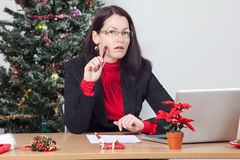 Business woman while winter holidays. Business woman making a christmas present wish list Royalty Free Stock Photo