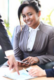 Business woman woking with a tablet Royalty Free Stock Photo
