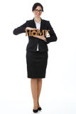 Business woman with a wooden sign with the words home. Business woman with a wooden sign Royalty Free Stock Photo
