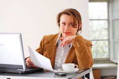 Business woman at work. Portraite of a young beautiful business woman executive at work Royalty Free Stock Image
