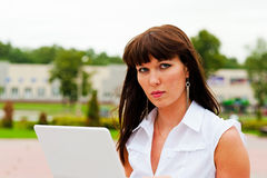 Business woman at work. Portrait of business woman who works with netbook Royalty Free Stock Image