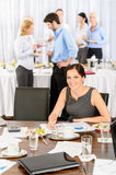 Business woman work during catering buffet Royalty Free Stock Photo