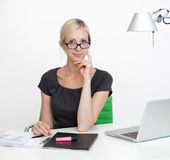 Business woman at work desk Stock Photography