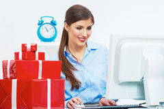 Business woman at work in office. Red gift box on table Stock Photo