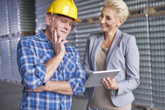 Business woman with worker in warehouse Royalty Free Stock Photo