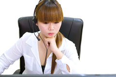 Business woman working. On computer in office Royalty Free Stock Photography