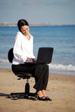 Business woman working at the beach Royalty Free Stock Images