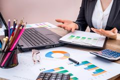 Business woman working with business graph at office, financial report stock image