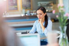 Business woman working at cafe Royalty Free Stock Image