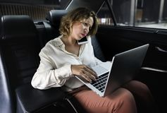 Business woman working in a car Royalty Free Stock Photos