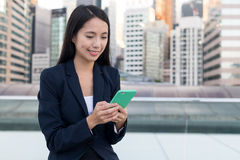 Business woman working on cellphone in city of Hong Kong. Asian young woman Royalty Free Stock Photo