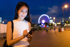 Business woman working on cellphone at night. Asian young woman Stock Image