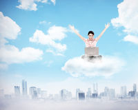 Business woman working on the cloud above the city Stock Photos
