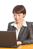 Business woman working on computer. Beautiful business woman(Asian/Chinese/yellow race) is working on computer Royalty Free Stock Image