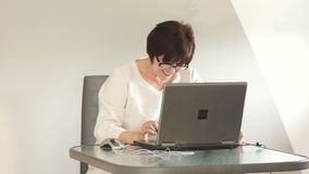 Business woman working at the computer. Chief editor, secretary, freelancer stock footage
