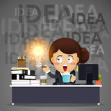 Business woman working on computer with idea bulb Royalty Free Stock Image
