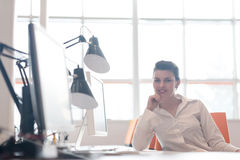 Business woman working on computer at office Stock Photo