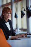 Business woman working on computer at office Stock Images