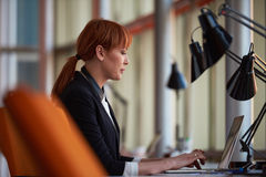 Business woman working on computer at office Royalty Free Stock Photo