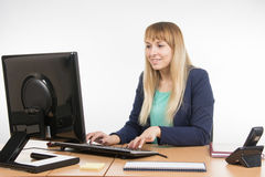 Business woman working at the computer in the office Stock Image