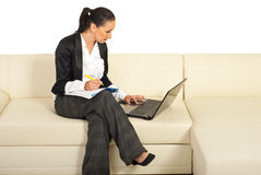 Business woman working on couch Stock Photos