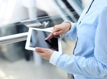 Business woman working with a digital tablet Stock Photo